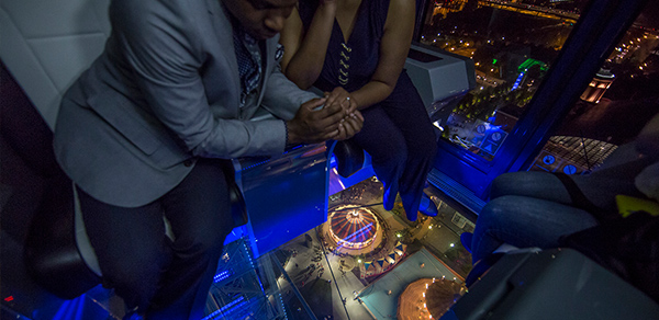 A couple enjoys a ride on the VIP Gondola on Navy Pier's Centennial Wheel